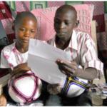 kids reading letter from sponsor