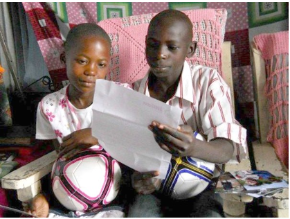 kids reading letter from sponsor